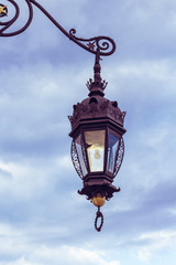 Fototapeta na wymiar Old lantern, medieval street light  in the street on the light background in Krakow. Poland