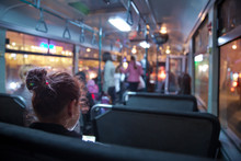 People In Old Public Bus, View From Inside The Bus . People Sitting On A Comfortable Bus In Selective Focus And Blurred Background. S The Main Mass Transit Passengers In The Bus.