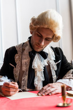 Selective Focus Of Handsome Victorian Man In Wig Writing Letter