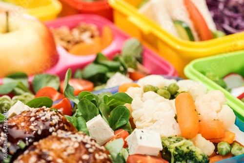 Spoed Fotobehang Eten close up view of fresh delicious food in lunch boxes