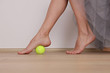 Leinwanddruck Bild - Flat Feet Correction exercises with a ball . Woman massaging her feet. Posture correction, Physical therapy.