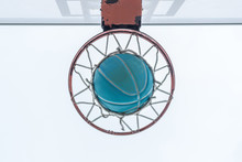 A Basketball Goes Through The ...