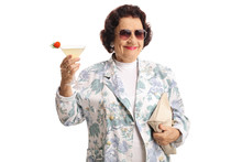 Elderly Woman Smiling And Holding A Coctail And A Purse
