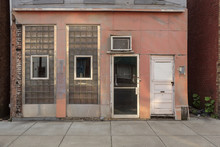 Ratty Looking Storefront With Frosted Glass In Small Midwestern Town