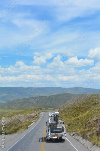 Autocollant pour porte Amérique du Sud Car on the road among Andean mountains.