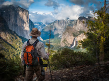 Hiker Pauses To Enjoy A View Of Bridalviel Fall