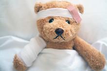 Teddy Bear Lying Sick In Bed W...