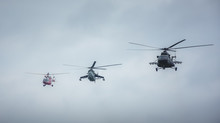 Military Helicopters Flying Towards The Action. Rescue, Assault And Cargo Helicopter.
