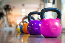 Colorful Kettlebells In A Gym...