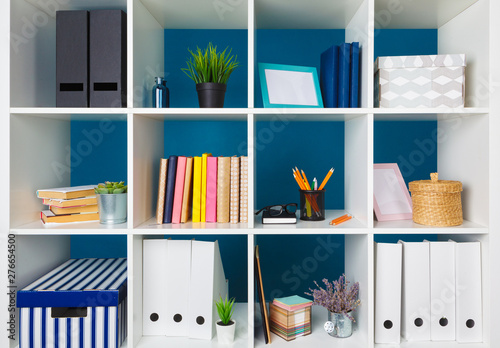Obraz White office shelves with different stationery, close up - fototapety do salonu