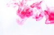 pink paint diluted in water on a white background