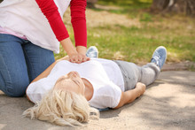 Female Passer-by Doing CPR On ...