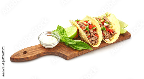 Board with tasty fresh tacos on white background