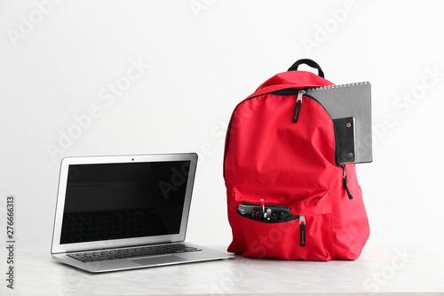 Obraz School backpack and laptop on white background - fototapety do salonu