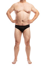 Adult Fat Man In Black Shorts, Full-length, Front View. Isolated On A White Background. Vertical.