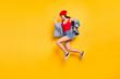 Profile side full size photo of energetic trendy stylish lady jogging isolated over yellow background