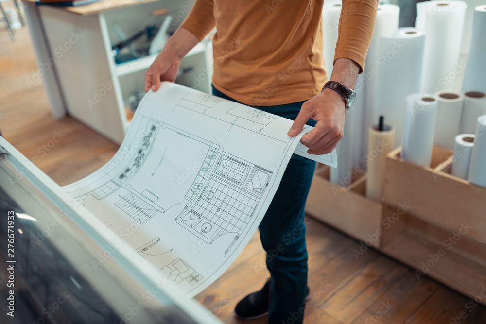 Fototapety, obrazy: Top view of interior designer printing the scheme of apartment