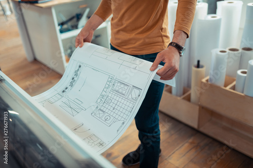 Obraz na plátně Top view of interior designer printing the scheme of apartment