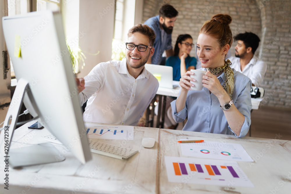 Fototapeta Business, technology and people concept - creative team or designers working in office