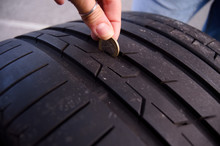 Measuring Tire Depth Using A Small Coin