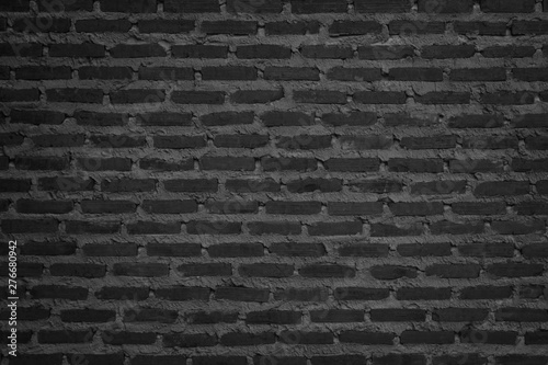 Foto op Plexiglas Historisch geb. Wall dark brick wall texture background. Brickwork or stonework flooring interior rock old pattern clean concrete grid uneven bricks design stack.