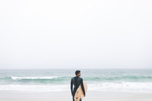 Male Surfer Holding Surfboard ...