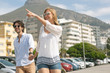 Caucasian couple walking on the promenade on a sunny day