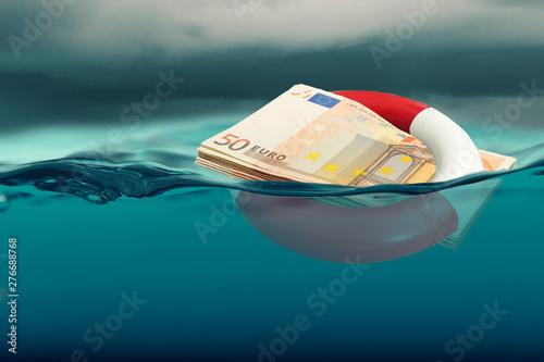 Fotografering Euro rescue concept - bank note modified
