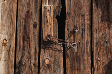 Old Wooden Gates With Black Ba...