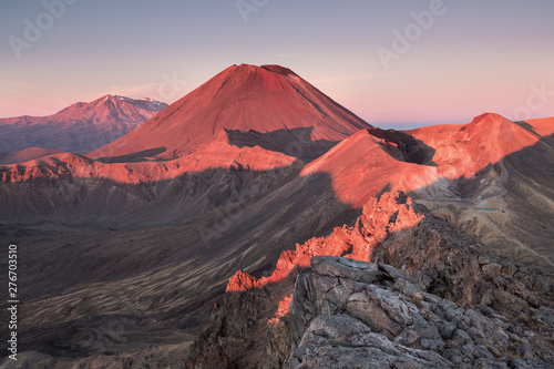 Montage in der Fensternische Rosa hell Early morning sunrise, landscape scenery of blue lake, wild mountains and huge volcano, autumn colours and golden sun rays, Tongariro National Park New Zealand North Island. Beautiful summer scenery