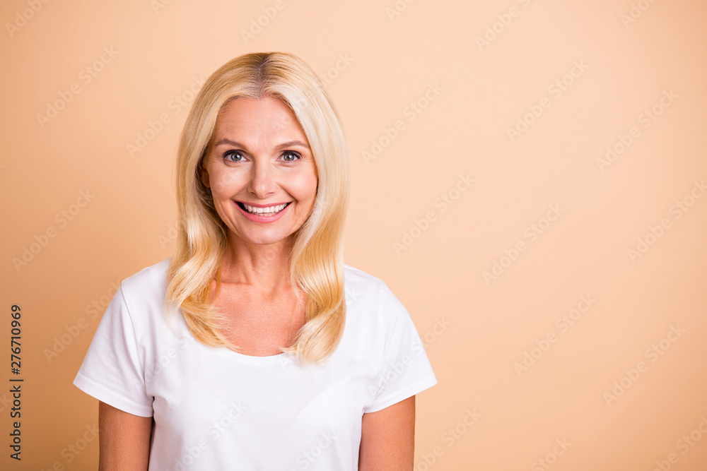 Fototapeta Closeup photo of middle age lady smiling neat appearance good-looking wear white casual t-shirt isolated pastel beige background