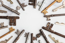 Frame Of Vintage Keys On White Background. Safety And Security Concept