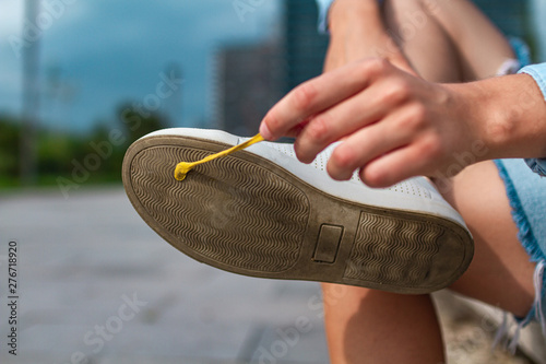 Photo  Sticking chewing gum on footwear close-up