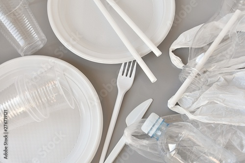 Fotomural  Plastic products, plates, fork and knife, produce bags, straws, cups, bottles