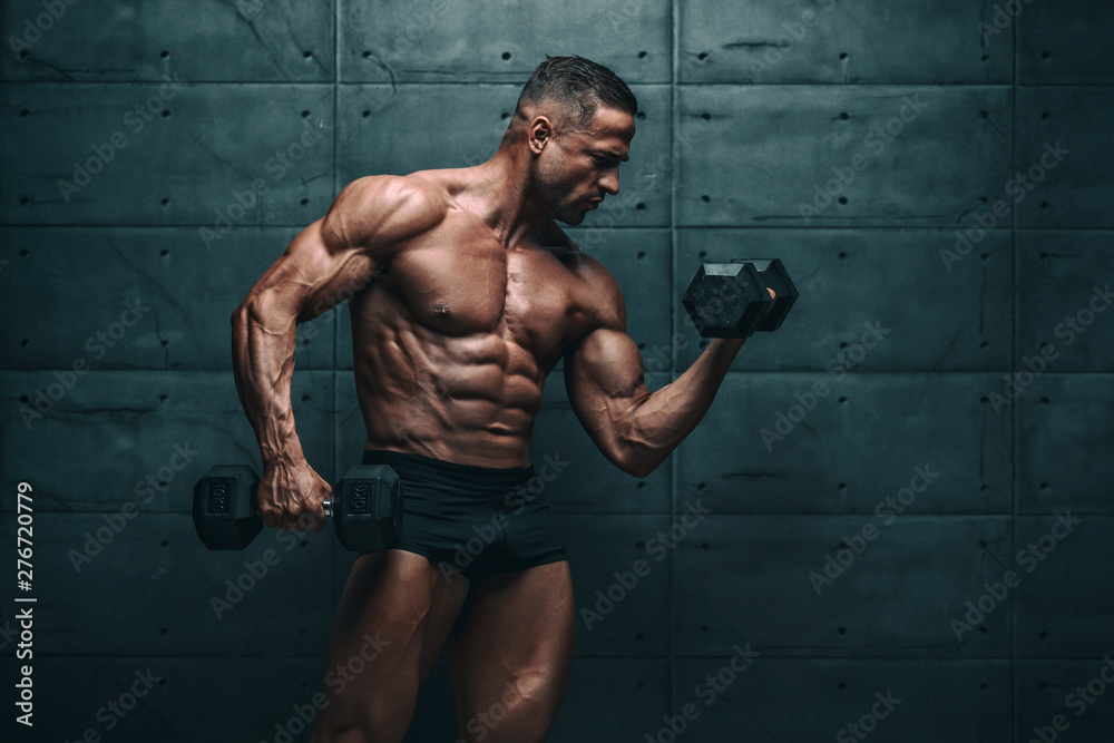 Fototapety, obrazy: Muscular Men Exercise With Weights. He is performing biceps curls with dumbbels