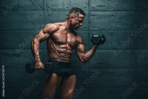 Fotografie, Obraz  Muscular Men Exercise With Weights