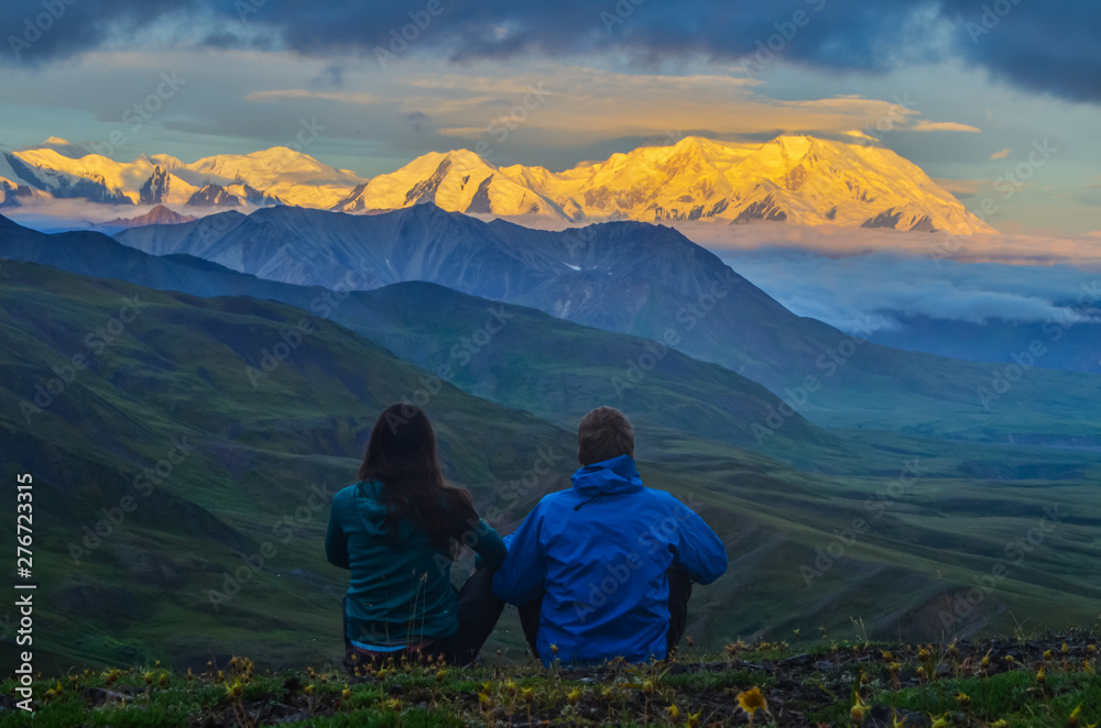 Fototapety, obrazy: Sunrise view of Mount Denali - mt Mckinley peak with alpenglow during golden hour with two persons from Stony Dome overlook. Denali National Park