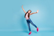 Full Length Body Size View Charming Cute Child Have Free Time Holidays Laugh Laughter Feel Content Rejoice Stylish Trendy Dressed Fashionable Jeans T-shirt Fuchsia Sneakers Isolated Blue Background