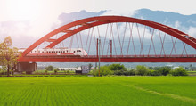 Landscape View Of Red Bridge With Train And Rice Filed At Yuli Hualien Taiwan.