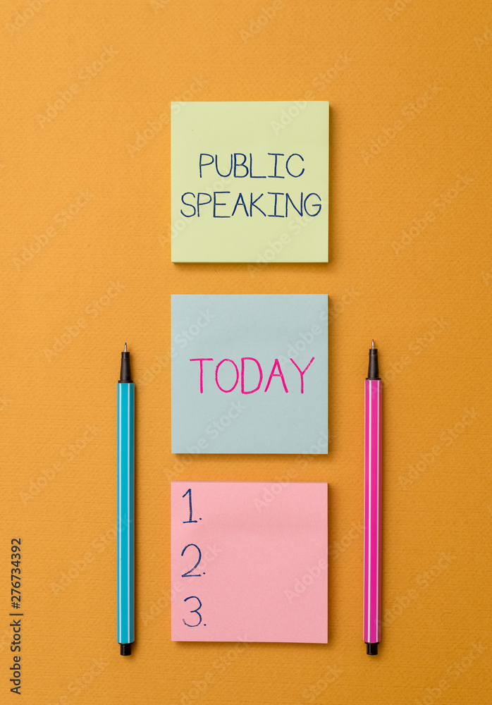 Fototapeta Writing note showing Public Speaking. Business concept for talking showing stage in subject Conference Presentation Front view colored sticky note two ballpoints cool yolk background