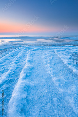 Fotografie, Obraz  A polar landscape in winter with ice and snow and a colourful landscape