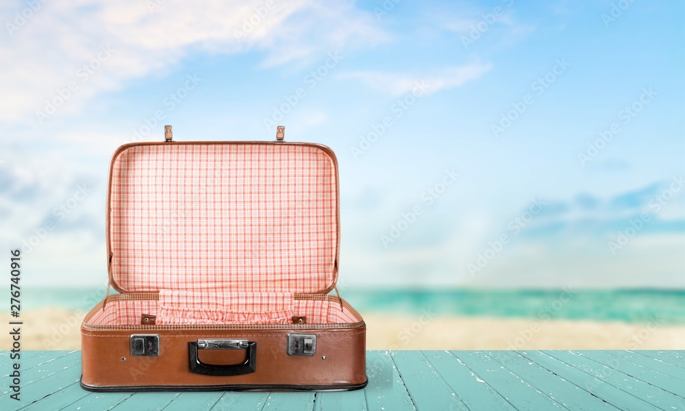 Fototapety, obrazy: Retro suitcase with travel objects  on sea background