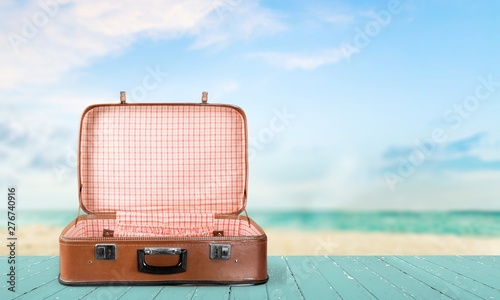Deurstickers Europa Retro suitcase with travel objects on sea background