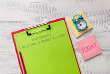 Handwriting Text Your Choices 1 Do It Now 2 Regret It Later. Conceptual Photo Think First Before Deciding Metal Clipboard Sheets Marker Alarm Clock Notes Pad Wooden Background