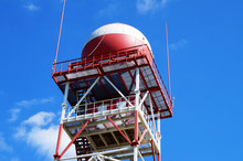 Red And White Water Tower On Blue Sky Background