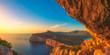 Leinwandbild Motiv Landscape of the gulf of capo caccia at sunset from grotta dei vasi rotti - Sardinia