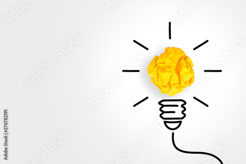 Obraz New Idea Concepts Light Bulb with Crumpled Paper on White Background - fototapety do salonu