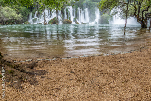 Fototapeten Forest river View from the beach to the Kravice waterfalls in Bosnia and Hercegovina