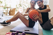 Couple Doing Exercise With Ball