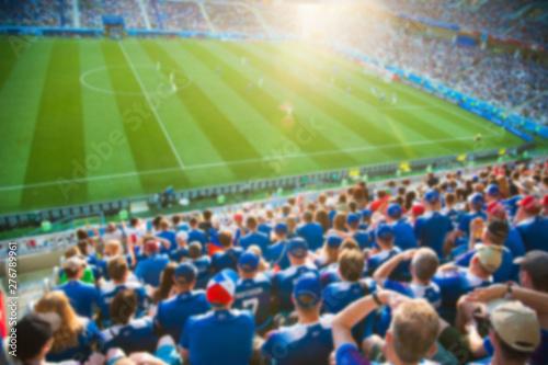 Obraz na plátně  Blurred crowd of spectators on a stadium